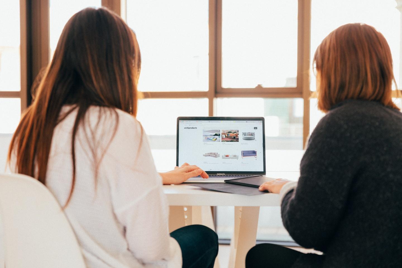 Women working laptop bright space