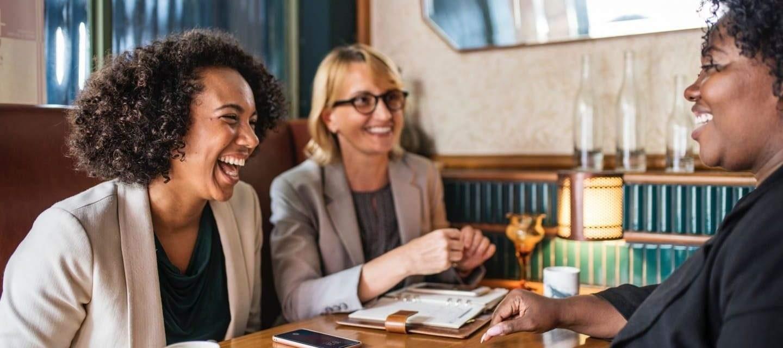 Women at sales meeting